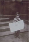 1910_Lewis_Hine_Child Labor_Young newsie working, pathetic story